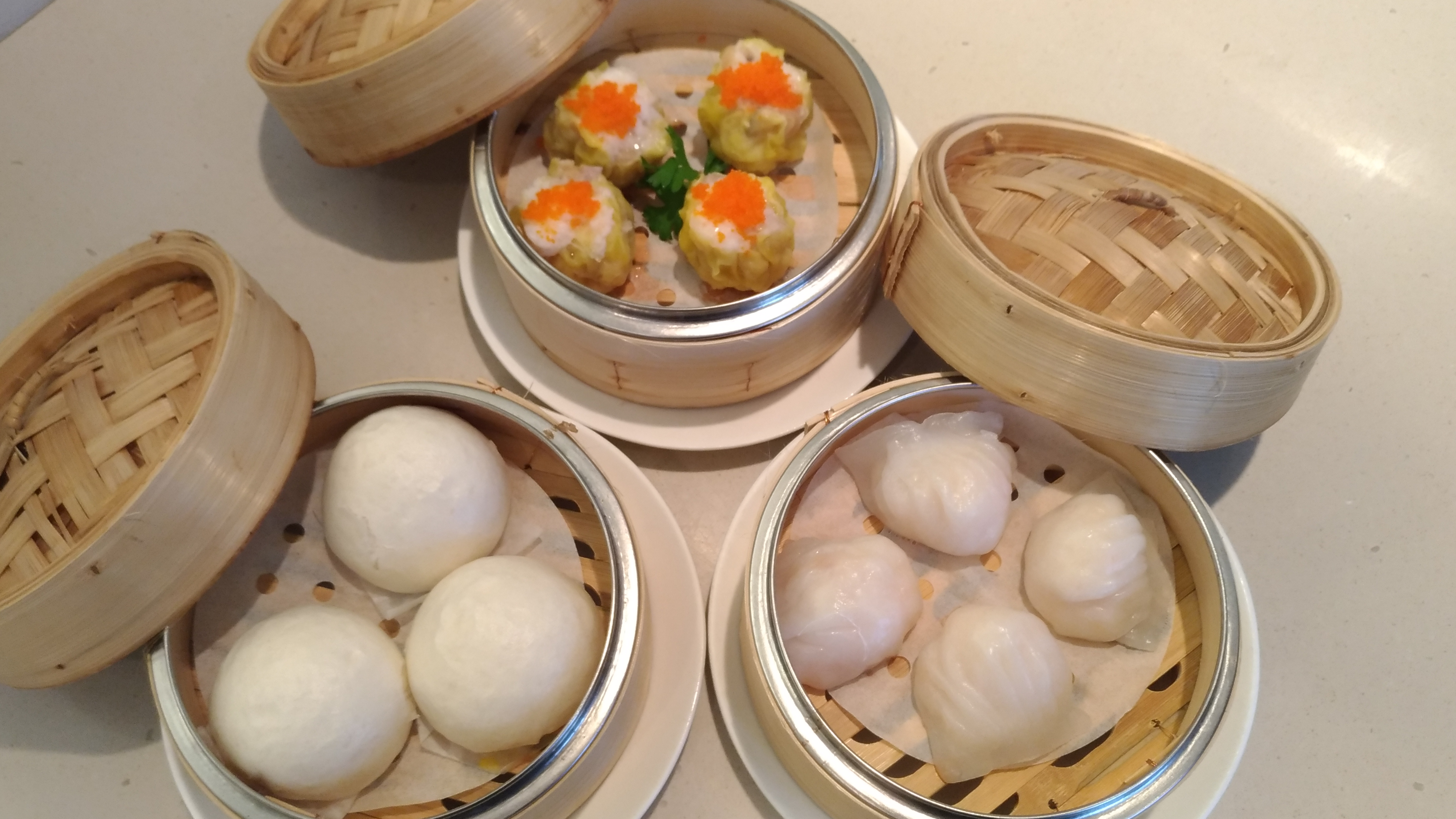We Sampled Some Of Their Dim Sum Dishes Such As Large Shrimp Dumplings,  Pork Siu Mai With Fish Roe, And Creamy Egg Yolk Custard Buns That Oozed Out  When You ...